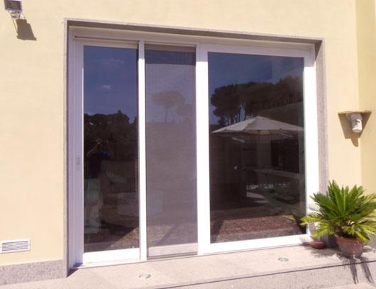 Zanzariera porta scorrevole pannelli termoisolanti - Tenda porta scorrevole ...
